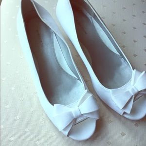 White wedged heels. With open toe, and white bows